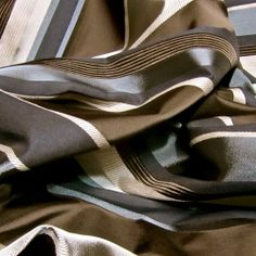 Looking for a sophisticated fabric with a masculine look? We just got in 11.5 yards of this Handsome Silk Kissed Durable Blue, Charcoal & Chocolate Multi-Textured Striped Upholstery Fabric. A great piece to inspire a new look for your favorite chair or an entire room.