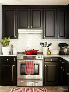 Classic & clean. Dark wood with subway tile back splash