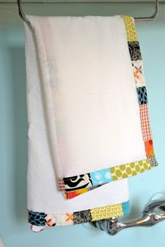 Cute bound flour sack towels. Fun & cheap and I hear flour sack towels clean up well