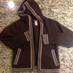 Women's small Patagonia lambswool hoodie cardigan. Women's small Patagonia lambswool hoodie cardigan.  No issues and NO TRADES. Patagonia Jackets & Coats