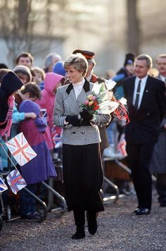 Princess Diana meeting the families of British troops serving in the Gulf War in Sennelage , Germany on 31st January 1991. The Princess wore a Alistair Blair creation with a smart black and white belted jacket worn with a calf-length black skirt and high necked pale pink silk blouse.
