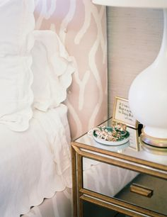 mirrored bedside table, scalloped sheets, headboard