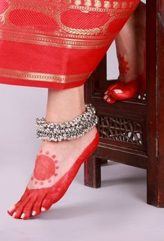 Ghungroo Lambani Anklet Traditionally, the Lambani women folk wear jewelry made out of copper, white metal and silver. Trying to revive the traditional lambani jewelry we have curated a collection of 22 carat gold and silver plated anklets