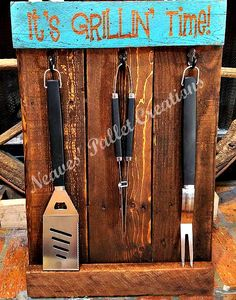 """RECYCLED PALLET WOOD:  We have a NEW Grillin' Station Organizer.  You will always know where the grill tools are! It will come with 2 """"D"""" Hooks for easy installation. The three new heavy duty cooking utensils come with the purchase of this Grillin' Station. They are 25"""" tall x 17"""" wide and has a 1.5"""" lip for setting matches/lighter or any other small items on. We are asking $24 for this Grillin' Station. Message us. Item#1,423"""