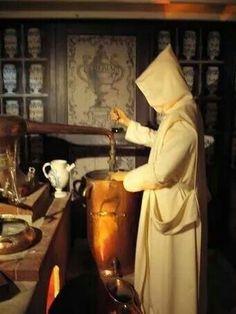 Trapist Monk making wine at the press.