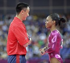 5. Gabrielle Douglas speaks with coach Liang Chow during the women's individual all-around competition. (AP)