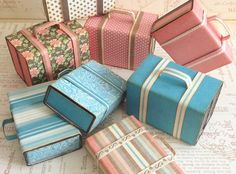 Learn how to create these cute mini suitcases using matchboxes...