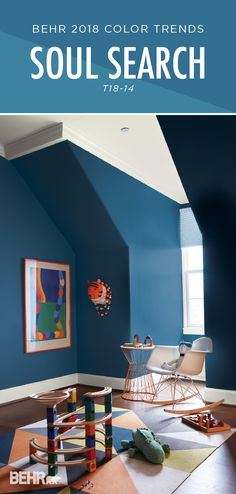 Add the deep, moody blue hue of Soul Search by BEHR Paint to these nursery walls, and you've got a globally inspired look that's fun and playful. This modern kid's playroom uses bright accent colors like orange, green, and yellow to create an inviting spa Behr Paint Colors, Interior Paint Colors, Color Trends 2018, 2018 Color, Living Colors, Playroom Design, Baby Boy Rooms, Baby Boys, Blue Rooms