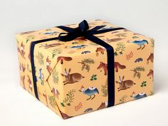 Girls would love this.  Forest Animals Wrapping Paper in Yellow by clapclapdesign on Etsy, $9.00