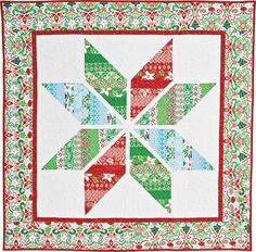 SNOW-KISSED STAR Free modern Lone Star wall quilt pattern Designed by KONDA LUCKAU This colorful jelly-roll-friendly lap quilt pattern is the very essence of modern Christmas décor! The Snow-Kissed Star lap quilt uses quick strip piecing to make short work of the sparkling star points, for a fun new take on the beloved Lone Star quilt.