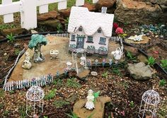 Photo by JANET B. CARSON                        /                        Special to the Democrat-Gazette<br />                       White picket fencing surrounds a fairy's little cottage in the Children's Garden at the Learning Fields, a River Valley (Sebastian and Crawford counties) Master Gardeners project at Chaffee Crossing.