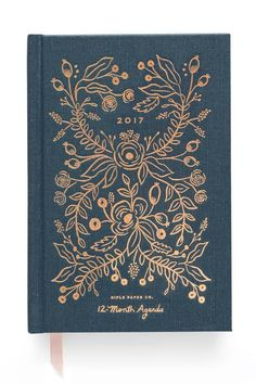 ": Our debut 12-month Midnight agenda is both beautiful and functional. The most compact format, this agenda feels like a slim novel. It features a navy book cloth cover, copper foil accents and perfect binding.    Measurement: 5.25×7.75""   2017 Midnight Agenda by Rifle Paper Co. . Home & Gifts - Gifts - Stationery & Office Austin, Texas"