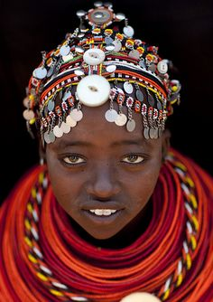 Rendille girl with pendants on her beaded headdress - Kenya