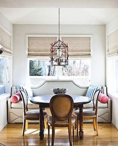 Sophisticated breakfast nook. Upholstered nailhead banquette, and French dining chairs.