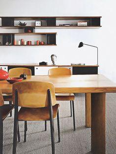 Jean Prouvé dining set, Charlotte Perriand shelving system, Mouille desk light.