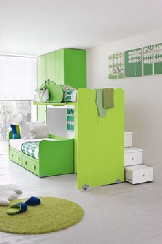 twist on traditional bunk beds & stairs appear to be additional storage.