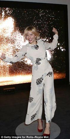 In bloom: Sienna Miller having fun in her  dandelion print jumpsuit...