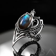 Nitya An exclusive, sterling silver ring with labradorite. Take even the simplest outfit to the next level with this gorgeous, sophisticated and noble design. A showcase piece, this ring shines by itself without the need for other jewelry. A perfect gift for yourself or someone special!  CIBA artistic jewelry can unexpectedly and completely change the character of an outfit. Try it and see for yourself! Click to see details!