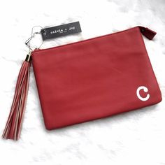 "Red Fringe Faux Leather ""c"" Clutch / Make Up Bag Brand new bag with tags from Olivia + Joy made from faux leather. Measurements are 10.5"" x 7"" and the bag is in perfect condition with gold hardware. Please ask if you have any questions! I also have this bag available in ""j"" and ""a"". Bundle and Save. Olivia + Joy Bags Clutches & Wristlets"