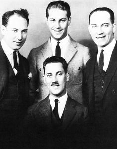 The Marx Brothers. On left is Harpo (Adolph, legally changed his name to Arthur during WWII) Next, standing center, Zeppo (Herbert) next on right is Chico (Leonard) Groucho is seated (Julius). Not in the photo is the brother Gummo, (Milton). Hooray For Hollywood, Golden Age Of Hollywood, Vintage Hollywood, Classic Hollywood, Hollywood Cinema, Classic Comedies, Classic Movies, Iconic Movies, Classic Tv