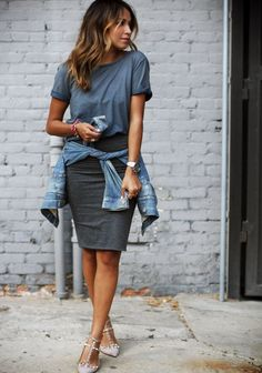 Shop this look on Lookastic: http://lookastic.com/women/looks/crew-neck-t-shirt-pencil-skirt-pumps-denim-jacket-watch/4327 — Charcoal Crew-neck T-shirt — Charcoal Pencil Skirt — Grey Leather Pumps — Blue Denim Jacket — Silver Watch