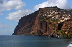 on Camara de Lobos island in the Madeira Island chain: The Cabo Girão is the highest sea cliff in Europe and the second highest in the world at 589 meters (1932 feet) high. Located 2km from Câmara de Lobos this place provides breathtaking views. If you suffer from vertigo do not approach the edge (protected by a railing) to look down at the Fajã do Cabo Girão.