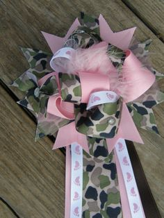 camo girl --baby shower corsage. for that very special occasion!!!!!!!!!!!!     Baby Shower Corsage is perfect for the Mom to be to wear at her baby