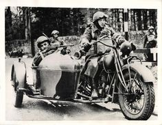 1941- Polish soldiers man a motorcycle equipped with a submachine gun during invasion maneuvers in Perthshire, Scotland.