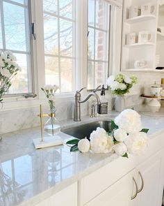 Pretty white kitchen with white cabinets, marble countertops, pretty faucet, windows over the sink. Home design decor inspiration ideas. home interior design chic modern ideas Rustic Kitchen Design, Farmhouse Style Kitchen, Home Decor Kitchen, Interior Design Kitchen, Home Kitchens, Kitchen Ideas, Rustic Kitchens, White Kitchen Decor, White Home Decor