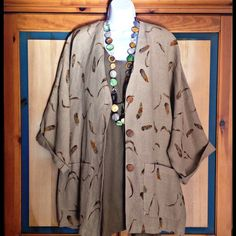 Awesome Oversized Linen Jacket or Short Coat Absolutely stunning jacket with two front pockets and shoulder pads. Depending on your personal style, this will fit sizes large and up. NWOT Bella Donna Jackets & Coats