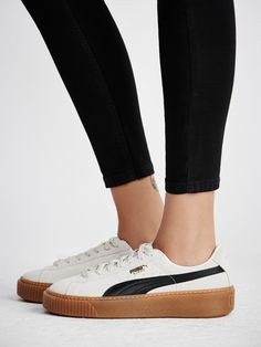 Suede Platform Core Sneakers   In a classic puma silhouette these casual suede sneaks feature a contrasting rubber sole. Lace-ups with a rounded toe.