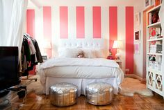Sometimes there is just the one accessory that really punctuates a space and brings it all together. Like these silver seats. Love the coral stripes as well. MM Alexandra Heitz's apartment