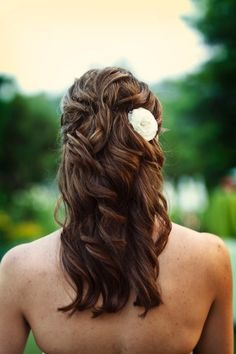 half up with flower accessory     (Photo By: Meg Runion Studios)