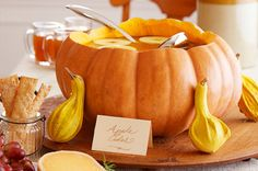 Make a pumpkin punch bowl for your next Halloween party! Not only does this idea look adorable, the pumpkin flavor will infuse your drink (apple cider, anyone?) with tasty fall goodness, too.