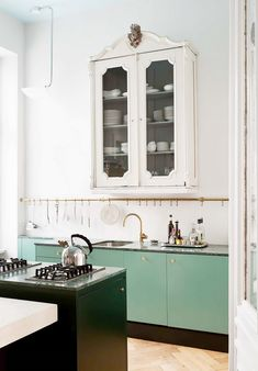 Mint is the perfect complexion for dowdy cabinets in need of an update. Just swap the doors out for modern versions in a seafoam green and watch your traditional kitchen come back to...