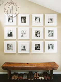 personal photo gallery + bench + fab chandelier = lovely entryway