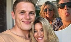 George Burgess and new fiancee Joanna King toast their engagement