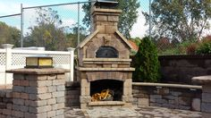 Wood burning outdoor fireplace - part of our Outdoor Showroom - come browse the huge selection at Miller Brick!