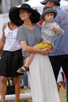 Marion Cotillard and her son Marcel cheer for her husband Marcel Canet during Longines Global Champions Tour