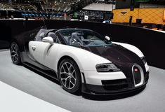 Called the fastest roadster in the world, the Bugatti Vitesse uses 4 turbochargers and 16 cylinders to churn out horsepower. Bugatti Cars, Bugatti Veyron, Supercars, Tire Pressure Gauge, Geneva Motor Show, Most Expensive Car, Fancy Cars, Car Posters, Car In The World