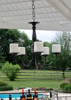 Pottery Barn Knock-Off Decor Outdoor Candle Chandelier Chandelier Makeover, Outdoor Chandelier, Candle Chandelier, Chandelier Shades, Outdoor Lighting, Outdoor Decor, Cheap Chandelier, Lighting Ideas, Chandeliers