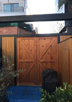 Our Recycled Oregon barn doors, timber salvaged from the Tottenham Munition Stores. Thanks to Black Door Building who did a marvellous job on this al fresco paradise in Carlton!