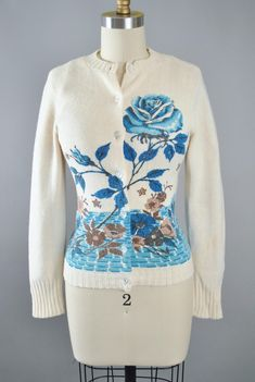 ♦ Vintage 1950s - 60s Cardigan Sweater by Bradley - Knitwear. ♦ Constructed in a Soft Knit Orlon Acrylyic Fabric. ♦ Beautiful Oversize Blue Floral Rose Print. ♦ Button Front Closure. ♦ Ribbed Hem & Sleeves.  ♥ PLS. Enlarge & ZOOM into All Photos, For a Better Detail of this Item!