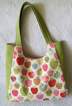 "At first, I made this one. The fabric is ""Farmdale"" from Alexander Henry. Then I made this one. The same beautiful apples, just smaller… the bag is also smaller, for a mother-daughter team. I also had in my stash these big apples, it's ""Apple of My Eye"" by Quilted Fish for Riley Blake. Big apples- …"