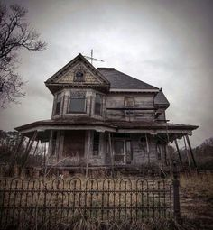 6 Eerily Beautiful Abandoned Funeral Homes & Morgues - A cemetery surrounds this dilapidated home, which was probably used as a morgue or funeral parlor, somewhere in the rural Midwest.