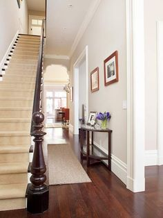 Historic Victorian Home Renovation Transitional Spaces To improve traffic flow in the narrow Victorian home, passageways were widened, allowing a see-through view of the main level. Natural light now fluidly flows throughout the space Narrow Staircase, Staircase Design, Open Stairs, Front Stairs, Home Renovation, Home Remodeling, Victorian Hallway, Staircase Remodel, Carpet Staircase