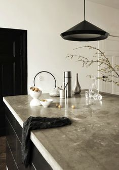 Light concrete bench tops and black cabinetry.