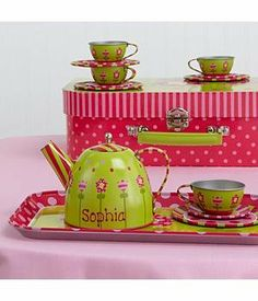 """Personalized NEW! Children's Metal Tea Set by Personal Creations. $39.99. Here's Everything She Needs To Host The Perfect Tea Party! This Pretty 16 Piece Tin Tea Set Contains 4 Teacups, 4 Saucers, 4 Plates, Teapot And Serving Tray--All With A Lovely Pink And Yellow Floral Design. We Hand Paint The Teapot With Any Name, Up To 10 Chars. Case Measures 11-1/2""""H X 8-1/4""""W X 3-3/4""""D. Ages 3 And Up. Hand Wash. Item Cannot Be Gift Boxed."""