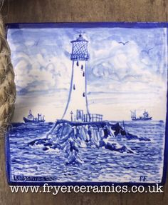 Longships Lighthouse, just over a mile off the coast of Cornwall.  Painted in blue underglaze on a handmade 12cm x 12cm tile.  Made of stoneware clay this would look lovely in a Cornish kitchen
