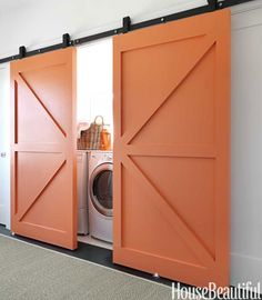I like how everything is neutral except the unexpected orange pop on the barn doors.  LOVE IT!